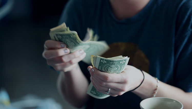 woman counting money dollar banknotes